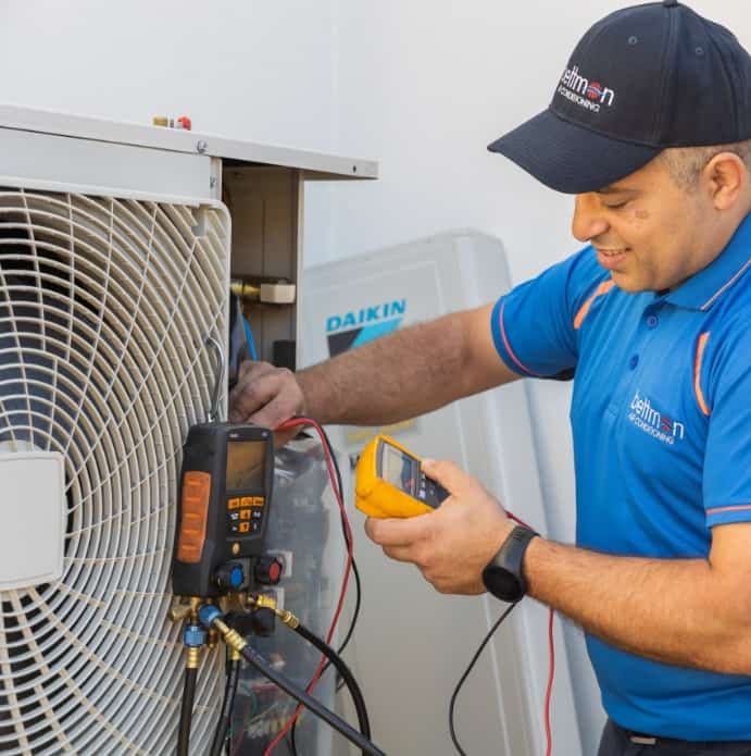 A man working with the aircon